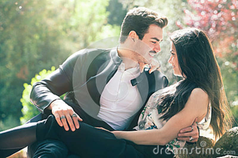 Couple love good feeling. Loving harmony. First romantic kiss. A young men and a young smiling woman. Love deep and bright feelings, the relationship between men and smiling woman. Attitude romantic and sentimental.