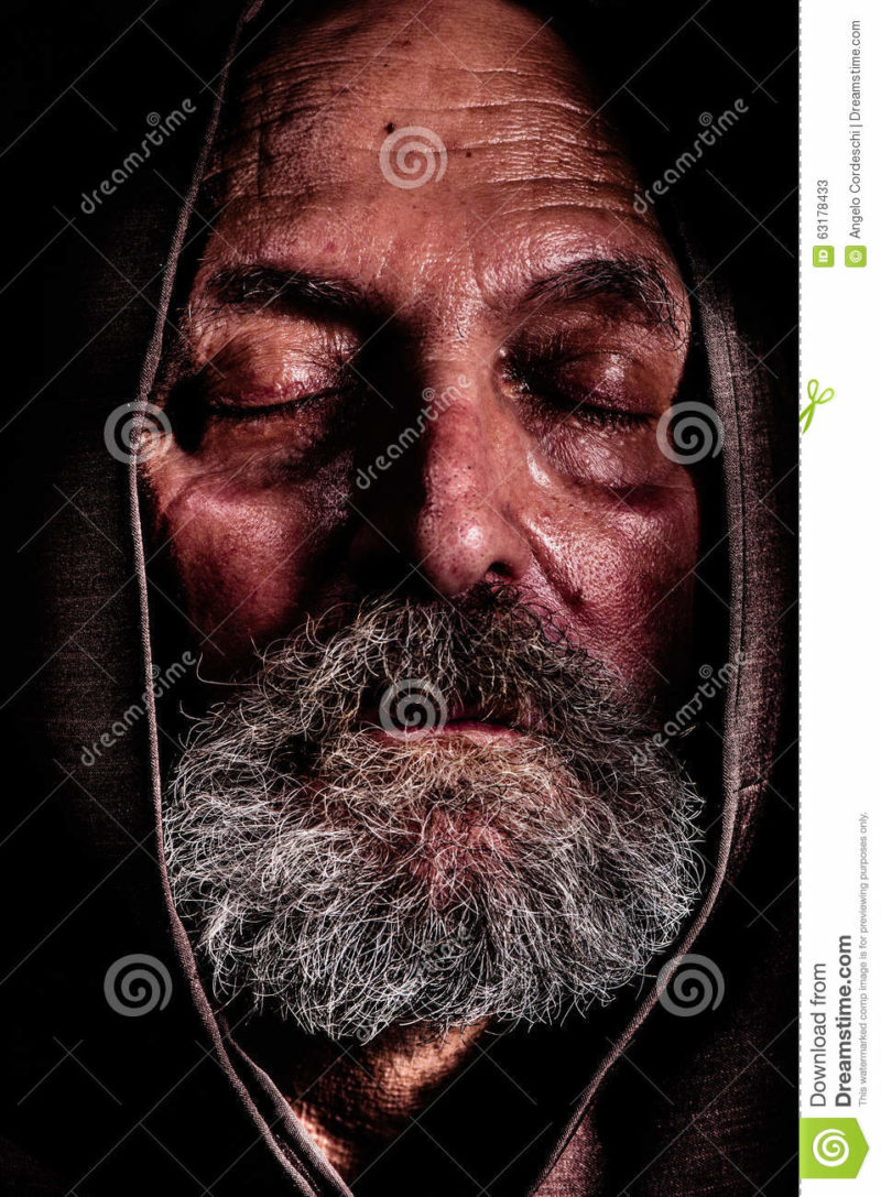 Homeless, a Capuchin friar. Bum poverty and suffering Homeless, a Capuchin friar. Bum poverty and suffering. Close portrait of an elderly man with eyes closed and with a hood over his head. Concept of abandonment, suffering, and aging. Effect high definition range, dragan.