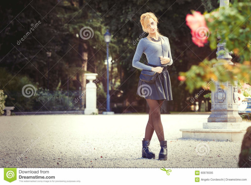 Teen love. Romantic girl outdoor A young blonde young girl outdoors in a park. Romantic scene. Outdoor fashion.