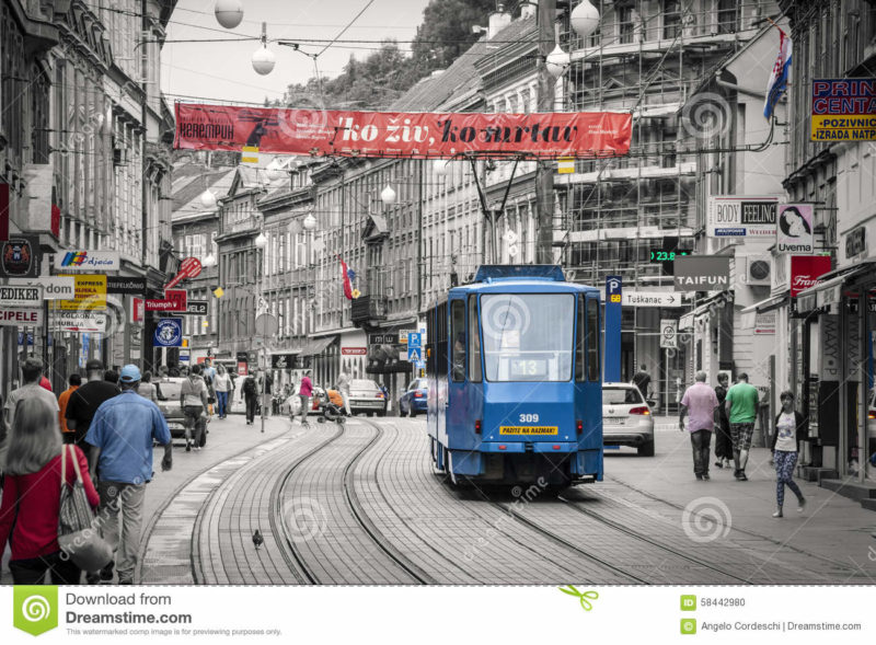 Zagreb, Croatia. Tram in the historic center of the city with the population and tourists. Black and white with colored details.