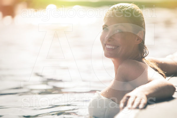 Enjoy The Summer Woman Relaxing In The Pool Water