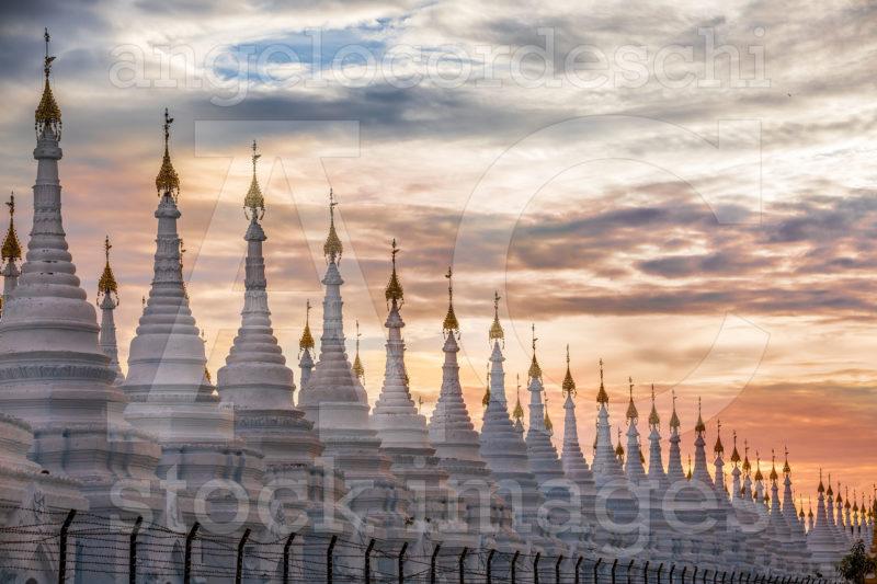 Pagoda Series In Line At Sunset In The Mandalay Region Aungmyaythazan In Burma