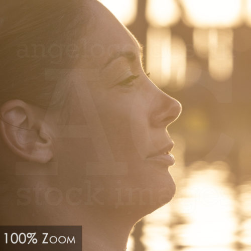 Woman Relaxing By The Pool At Sunset Zoom 100