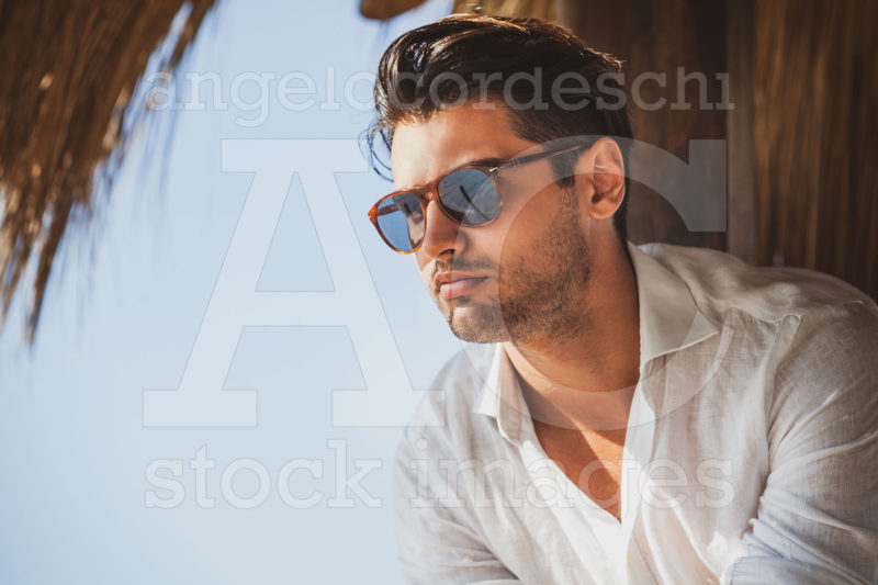 Young And Handsome Man With Sunglasses Looking