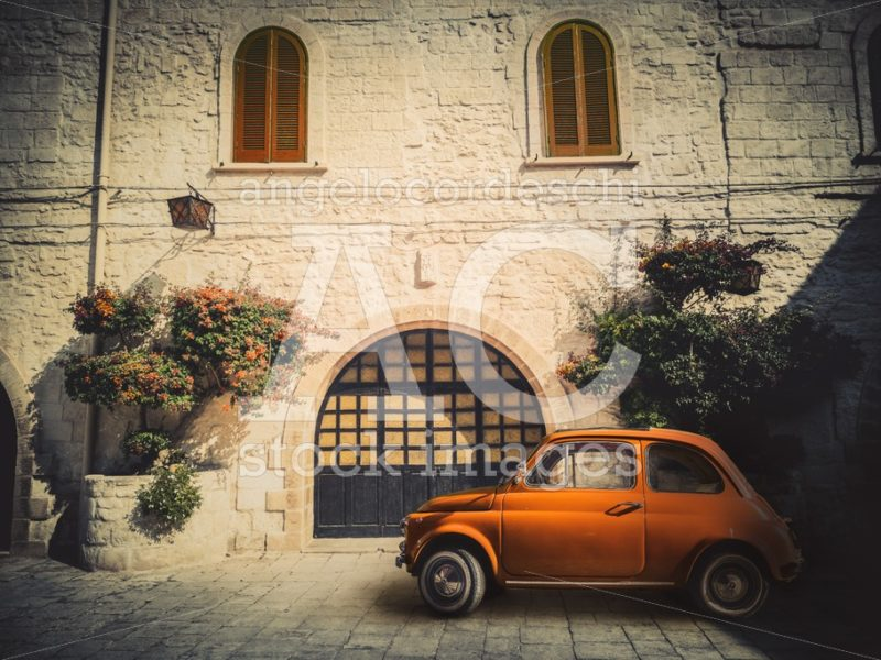 Antique Small Orange Italian Car, Parked On The Road In Front Of Angelo Cordeschi