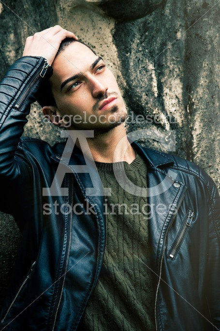 Beautiful Young Trendy Man With Hand On Head. A Cool Guy Posing Angelo Cordeschi
