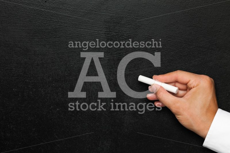 Black wall. Empty blackboard or chalkboard hand with white chalk - Angelo Cordeschi