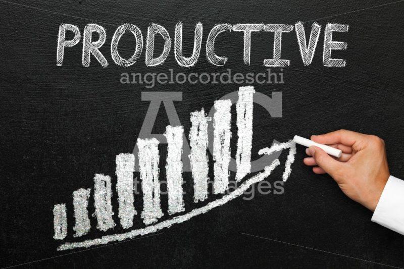 Blackboard with handwritten productive text. Arrow going upwards - Angelo Cordeschi