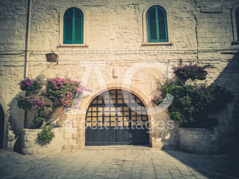 Entrance To An Ancient House With Arched Door, Windows And Ornam Angelo Cordeschi