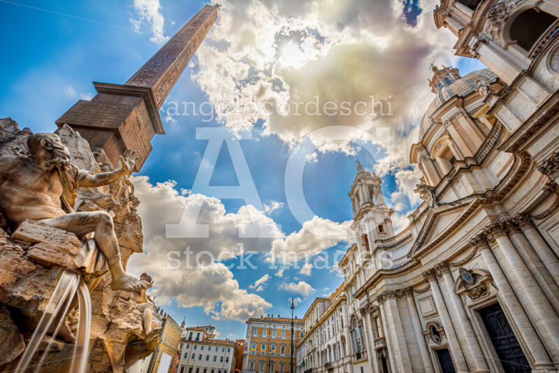 Fountain of rivers in Rome in Italy. In the background, the baroque church of Santa Agnese in Agone. - Angelo Cordeschi