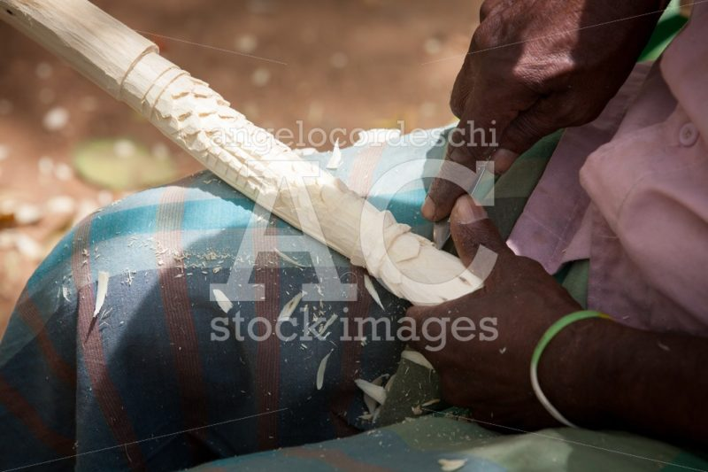 Hands Of Man Chiseling A Piece Of Wood To Make A Flute. Angelo Cordeschi