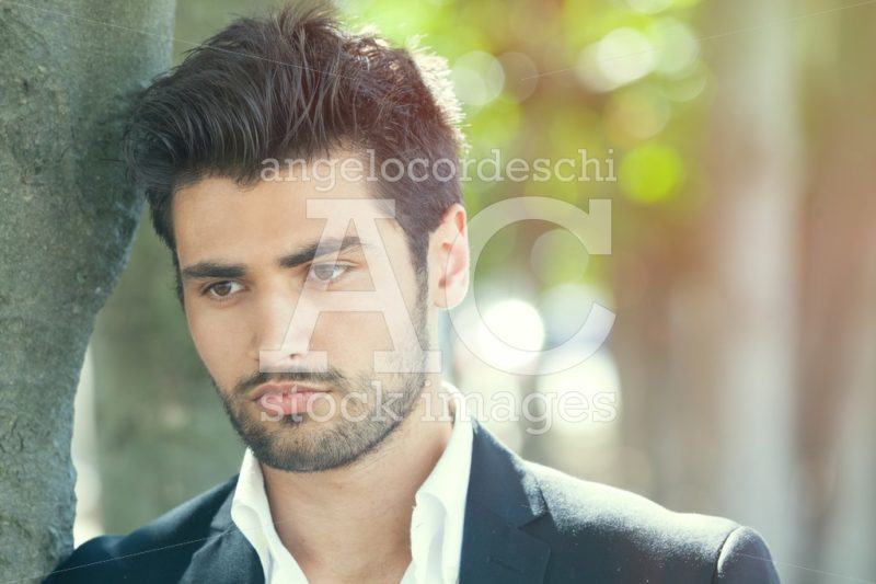 Handsome man, close portrait of young man with stubble beard. - Angelo Cordeschi