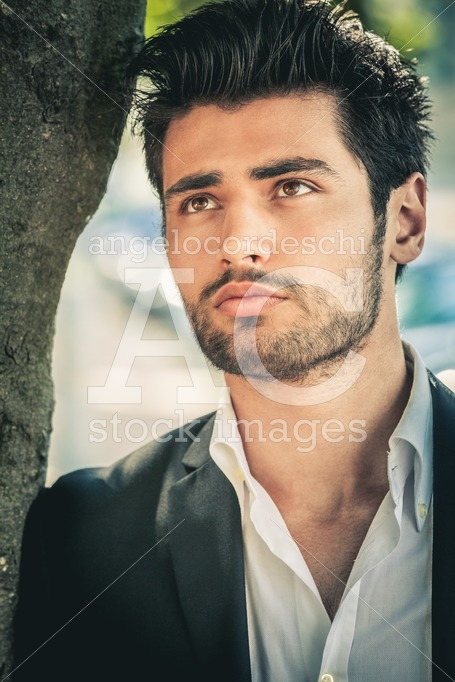 Handsome man, portrait of young man with stubble beard. - Angelo Cordeschi