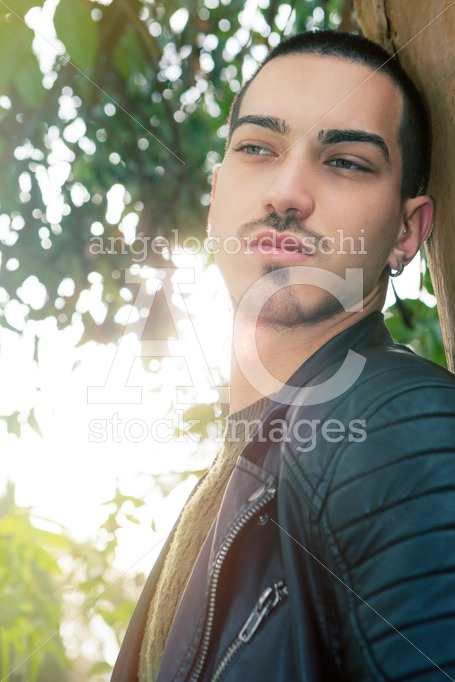 Handsome Young Man Leaning On A Tree. Natural Background In A Pa Angelo Cordeschi