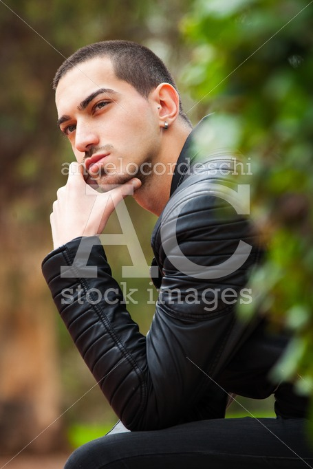Handsome Young Man Sitting Thinking. Short Hair. A Thoughtful Ha Angelo Cordeschi