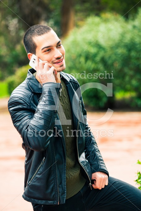 Happy Young Man With Smart Phone. Talking On The Phone. A Young Angelo Cordeschi