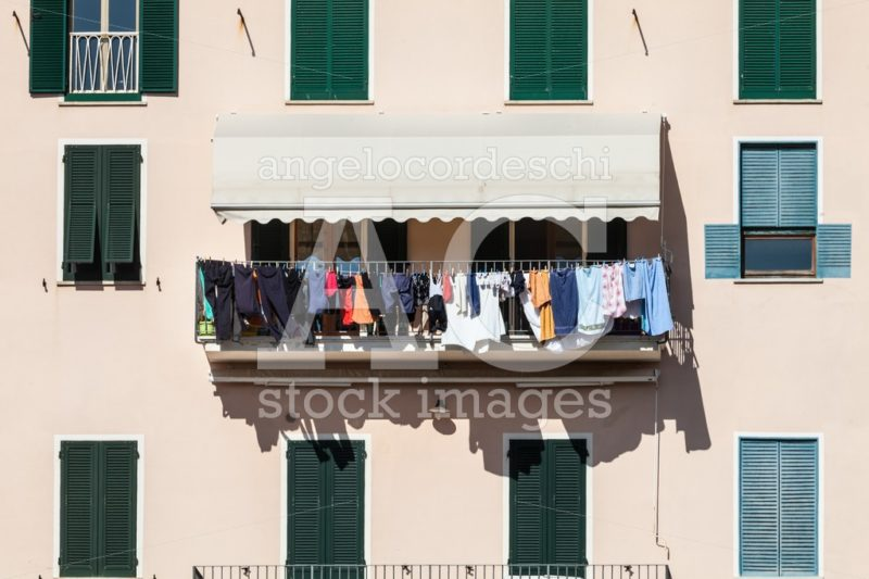House Facade With Clothes Hanging Out To Dry. Italian Culture. Angelo Cordeschi