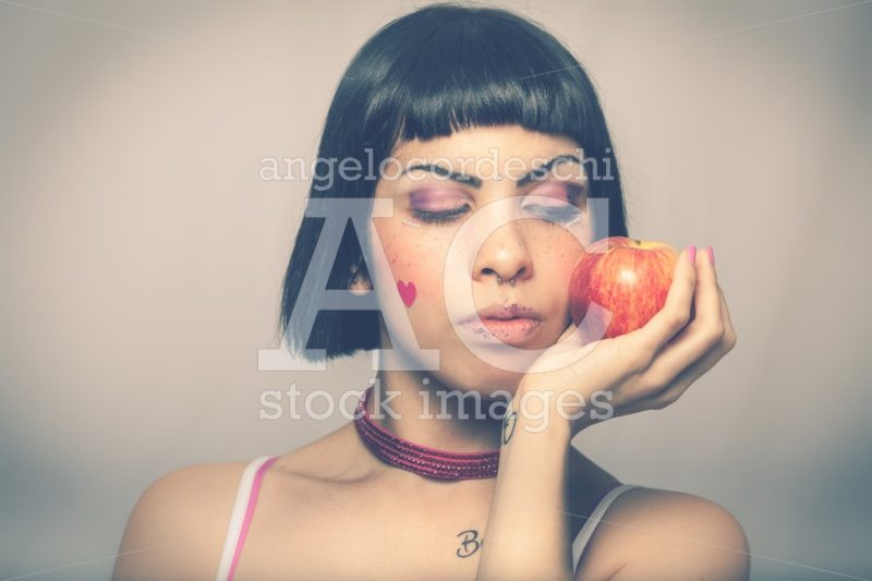 Loving nature. Young woman with apple. Young and beautiful girl - Angelo Cordeschi