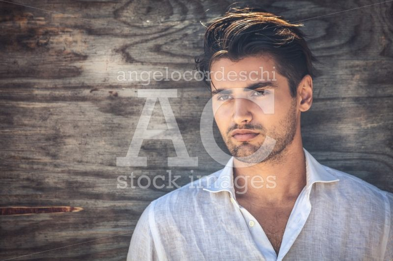 Man Portrait, Young And Handsome Man On Wooden Background. He Is Angelo Cordeschi