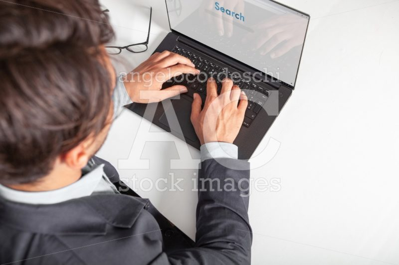 Man With Laptop Typing On The Keyboard Doing A Search Angelo Cordeschi