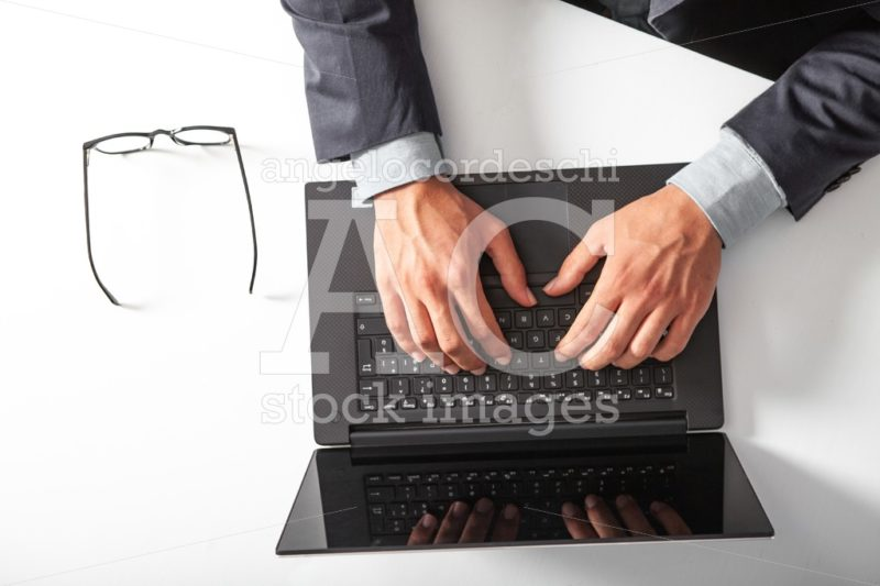 Man With Laptop Typing On The Keyboard. Black Screen. Angelo Cordeschi