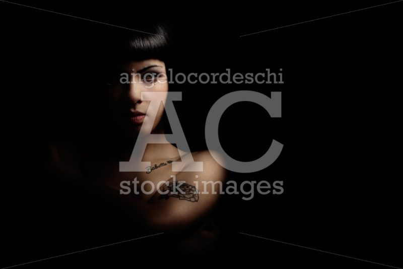 Mystery beautiful young woman in shadow and light. A beautiful y - Angelo Cordeschi