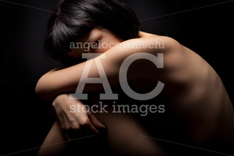 Naked Girl, Woman Curled Up In Protection On Black. Female Healt Angelo Cordeschi