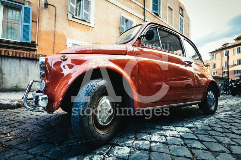 Old Compact Italian Car Fiat 500 Cinquecento Parked In The Histo Angelo Cordeschi