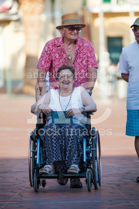 Porto Azzurro, Italy. June 26, 2016: Disabled Woman On A Wheelch Angelo Cordeschi