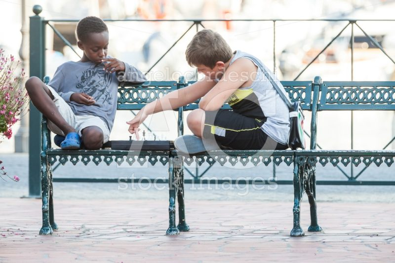 Porto Azzurro, Italy. June 26, 2016: Two Children Playing Chess Angelo Cordeschi