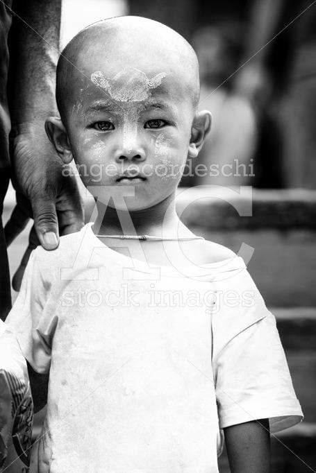 Portrait Of A Small Child Of Myanmar, Burma. Serious Look Lookin Angelo Cordeschi