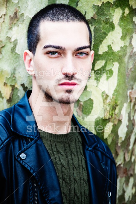 Portrait Of A Young Handsome Man Near A Tree. Tree With Camoufla Angelo Cordeschi