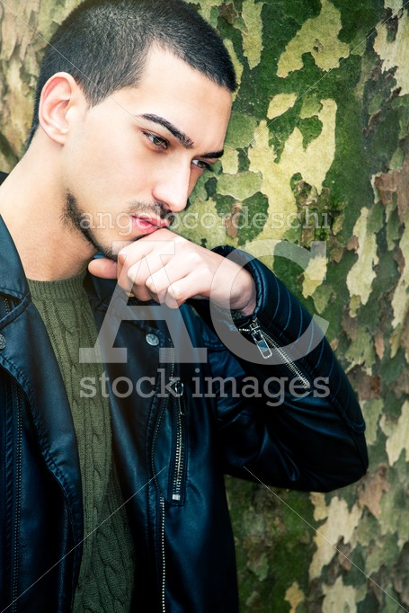 Portrait Of Thinking Young Man. A Guy With A Leather Jacket With Angelo Cordeschi