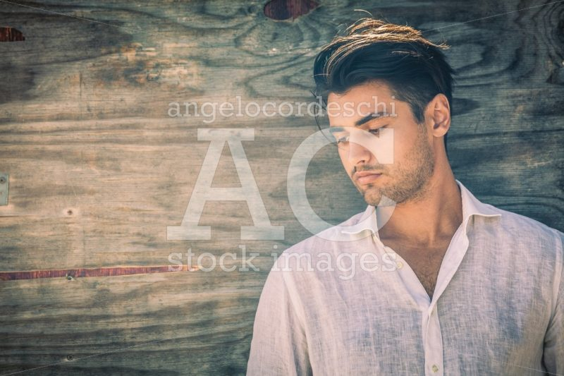 Profile Portrait Of Thoughtful And Handsome Man On Wooden Backgr Angelo Cordeschi