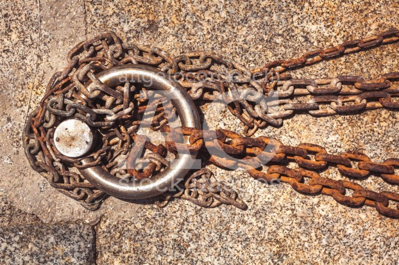 Rusty Steel Ring And Mooring Lines In A Seaport. Rusty Iron Chai Angelo Cordeschi