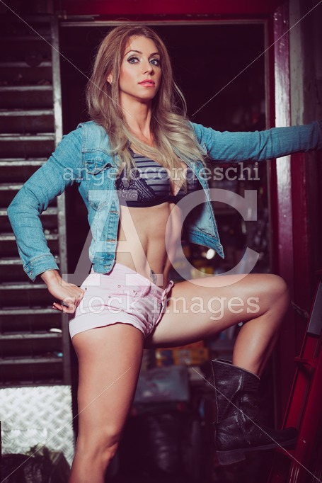 Sexy blonde woman in pink shorts with sculptural and fit physiqu - Angelo Cordeschi