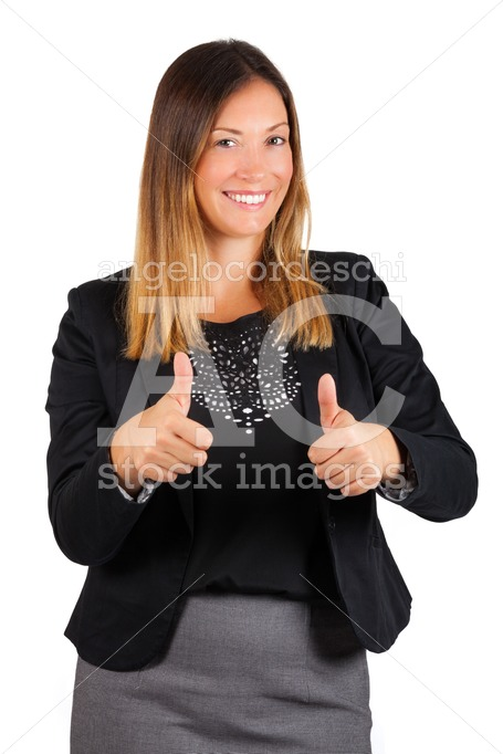 Smiling woman with thumbs up. On white background. - Angelo Cordeschi