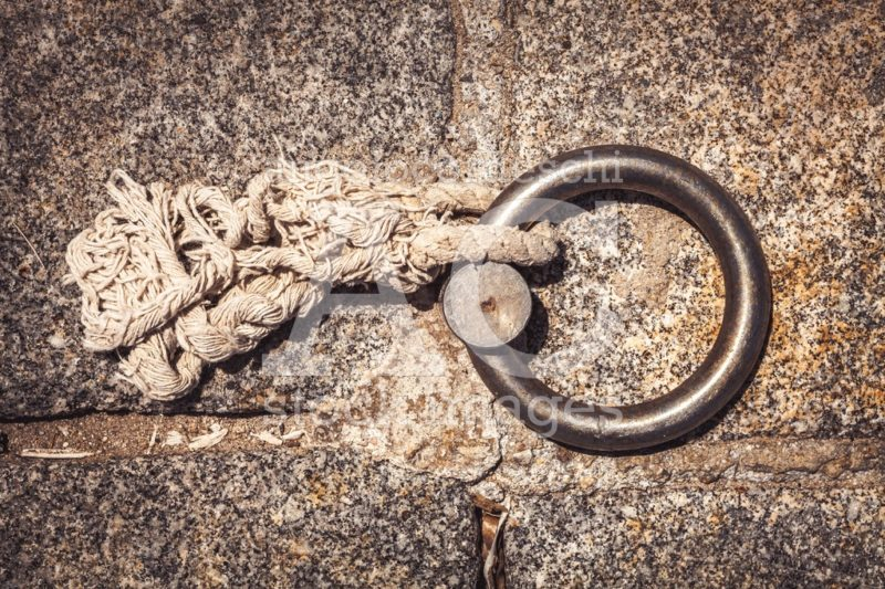 Steel Ring And Mooring Lines In A Seaport. Light Colored Hemp Ro Angelo Cordeschi