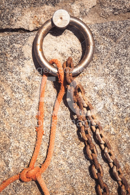 Steel Ring And Mooring Lines In A Seaport. Rusty Iron Chain And Angelo Cordeschi