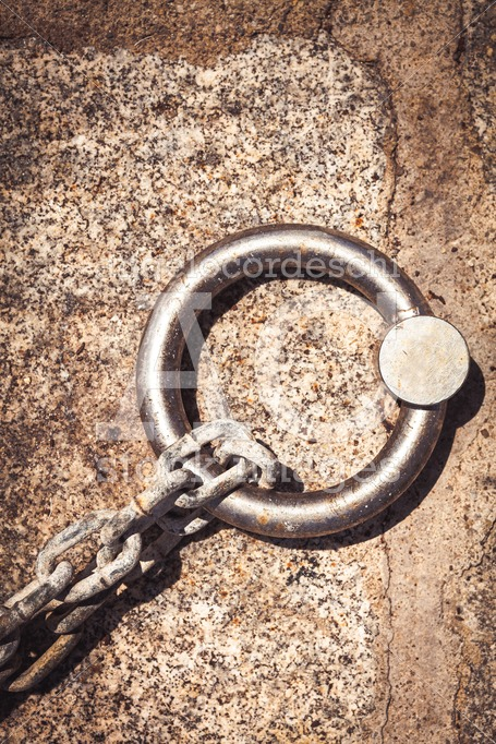 Steel Ring And Mooring Lines In A Seaport. Rusty Iron Chain On T Angelo Cordeschi