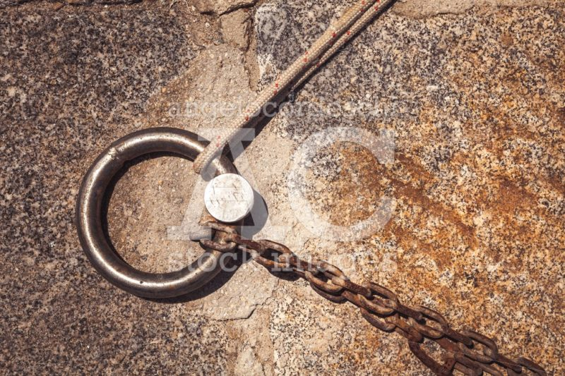 Steel Solid Ring And Mooring Lines In A Seaport. Rusty Iron Chai Angelo Cordeschi