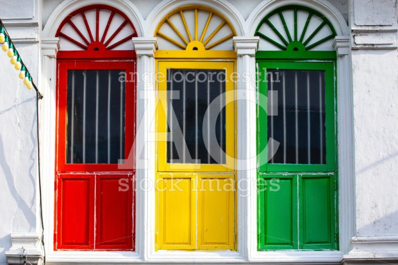 Three Colored Doors Or Windows Outside On The Facade Of An Ancie Angelo Cordeschi