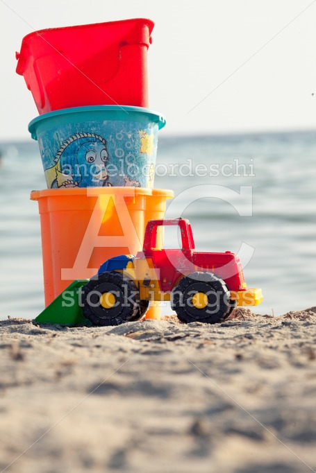 Toys For The Beach For Children On The Sand With Sea In The Back Angelo Cordeschi