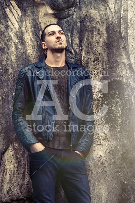 Trendy Man Leaning Against The Wall. Rock Style Clothing. Handso Angelo Cordeschi