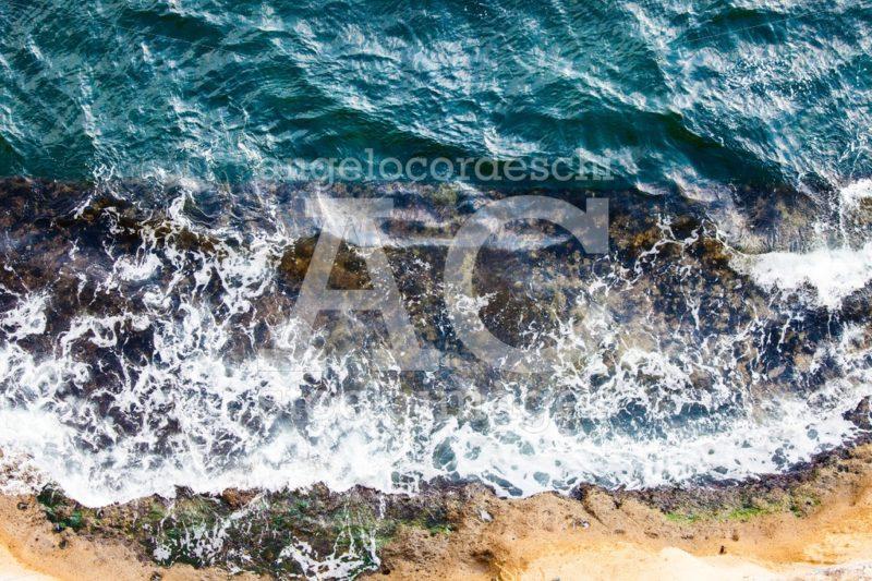 Waves crashing breaking on the rocks. Drone aerial sea surface v - Angelo Cordeschi