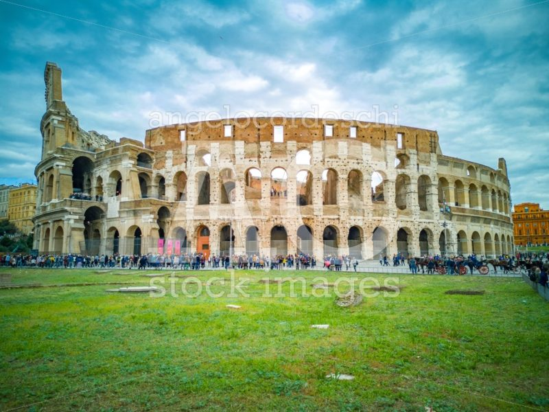 Whole Colosseum In Rome In Italy. Crowd Of Tourists People Along Angelo Cordeschi