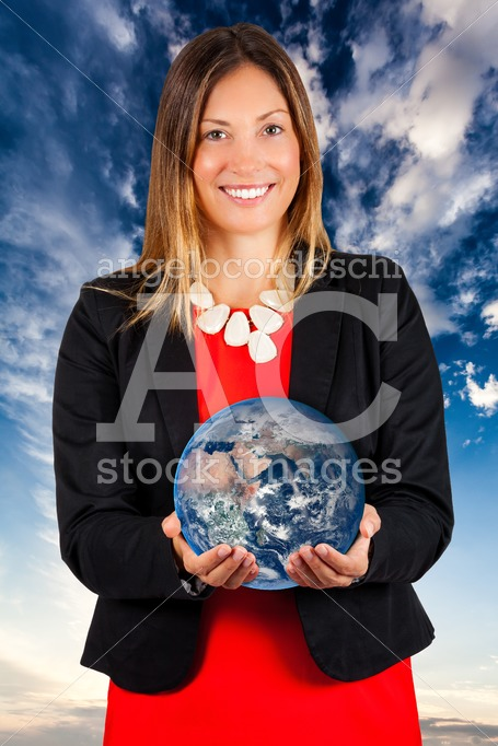 Woman Smiling With Earth In Hands. Sky Background. Angelo Cordeschi
