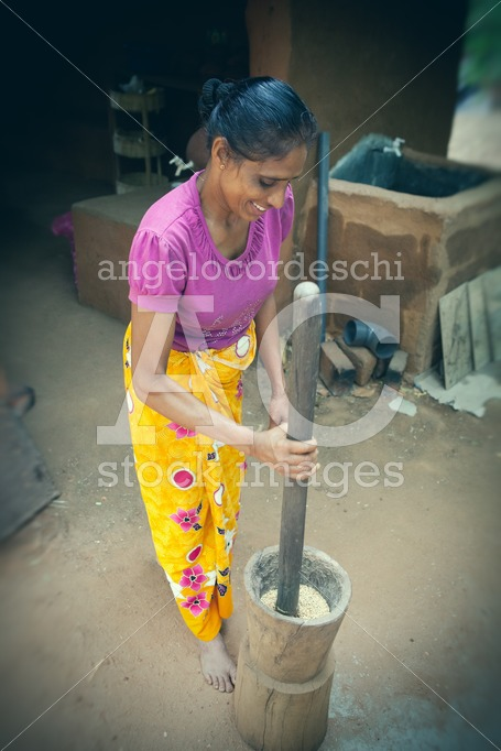 Woman working the rice. Skill for producing food. In an indigeno - Angelo Cordeschi