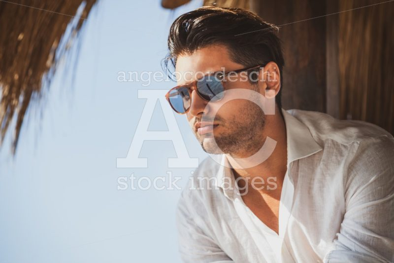 Young And Handsome Man With Sunglasses Looking Angelo Cordeschi