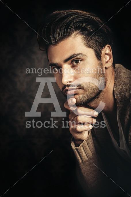 Young Handsome Man Portrait With Hand Under His Chin. In Studio, Angelo Cordeschi